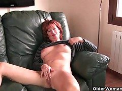 Redheaded mature mom plays with will not hear of nipples coupled with pussy