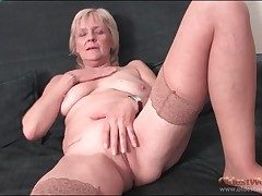 Granny strips in stockings plus fingers pussy