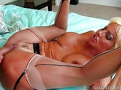 Mature slut Tara Holiday with ginormous fake tits is his